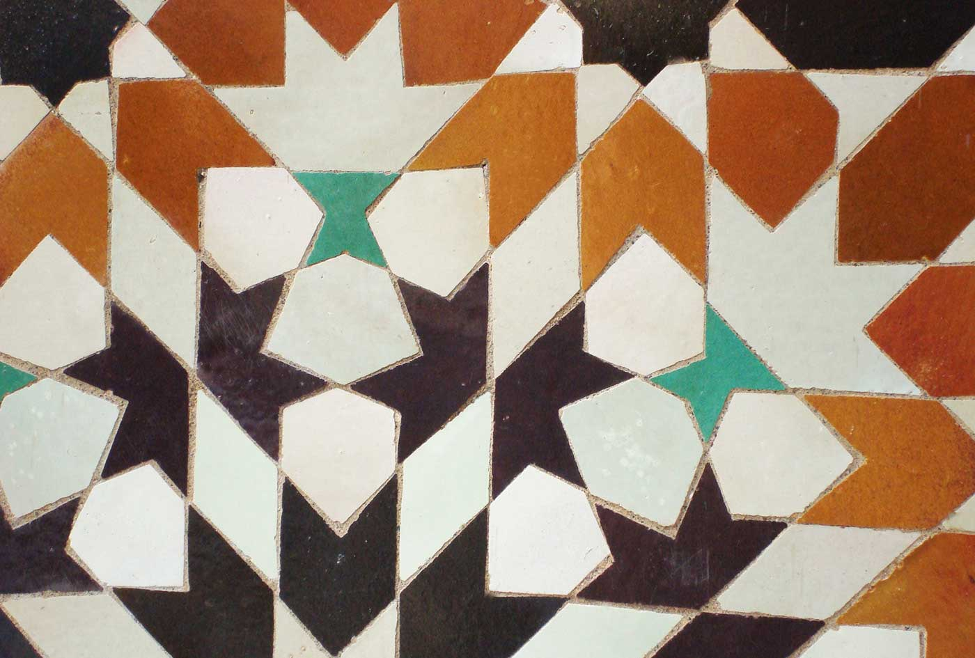 detail of an Islamic geometric composition in ceramic zillij tiles